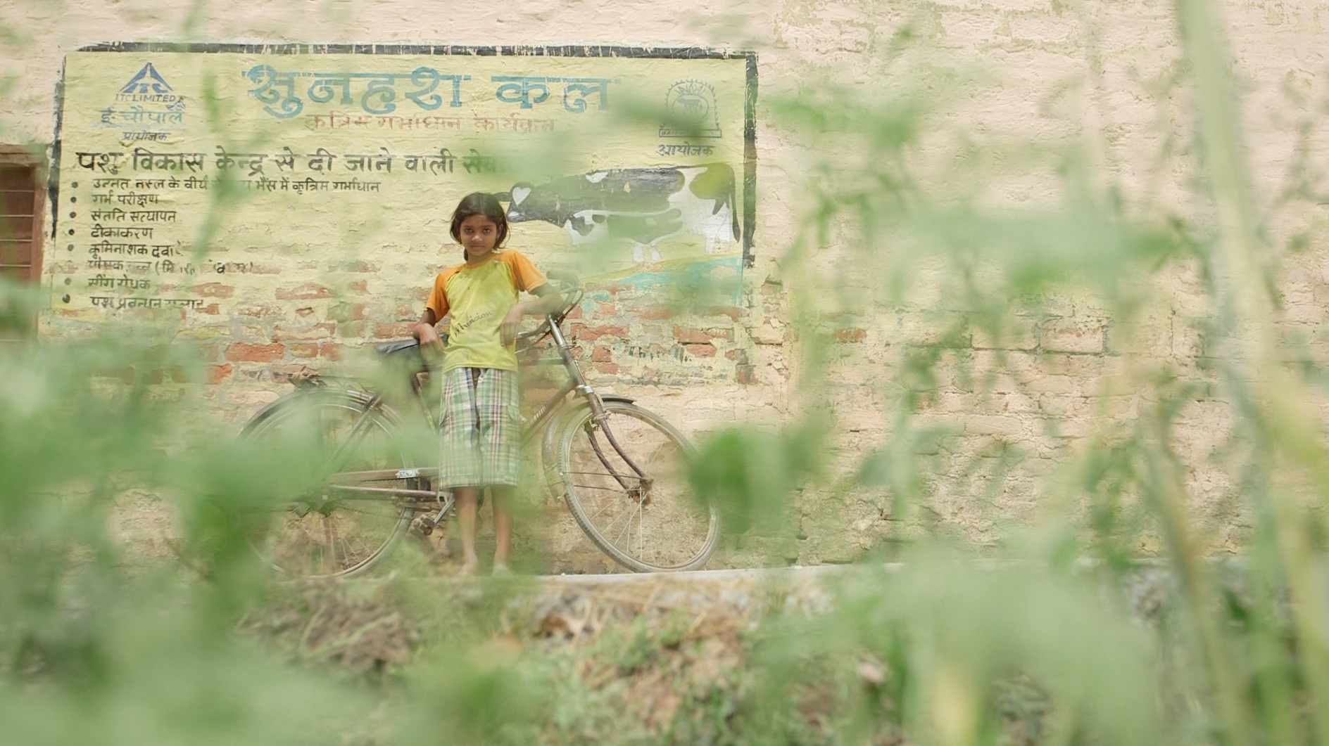 A girl in northern India with her bicycle