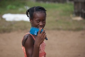 Girl in West Africa with wind up radio