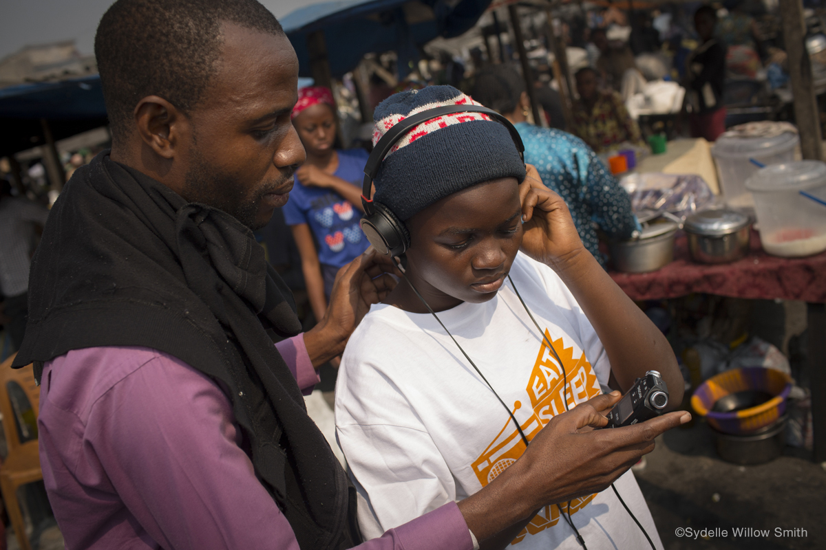 Coordinator Joachim Ambambo and Young Reporter Dorcas Belangi(©Sydelle Willow Smith)
