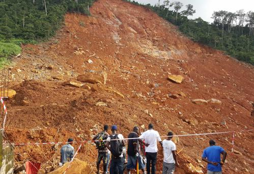 People gather at site of mudslide, Sierra Leone