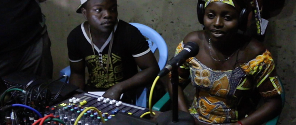 Umoja FM studio with presenter, DRC