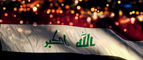 Iraq flag superimposed on night cityscape with lights