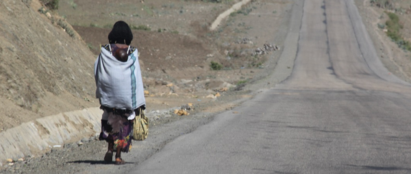 Mother and Child walk on road in NE Africa