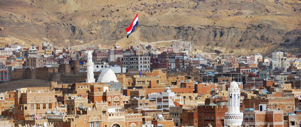 The old city of Sanaa with Yemen flag before being destroyed by conflict