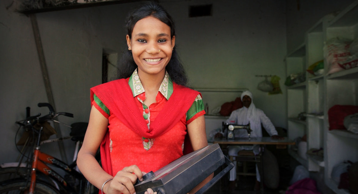 Listener smiles with her radio, India