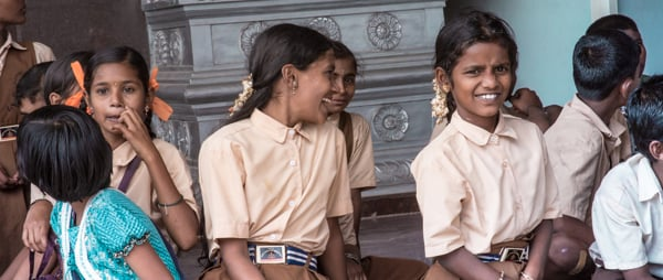 Indian schoolgirls smile on a school trip