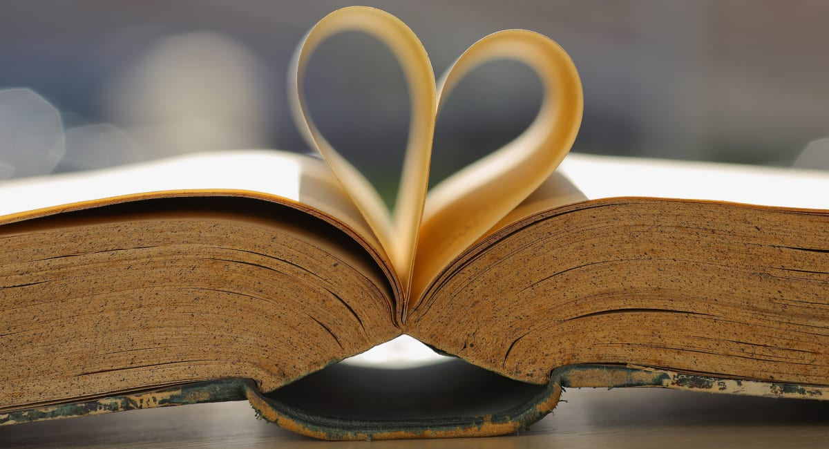 Bible pages folded in the shape of a heart