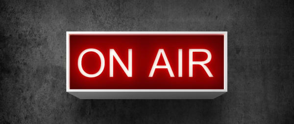 A red On Air radio studio sign
