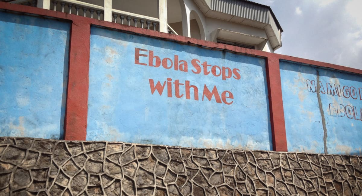 Ebola Stops with Me text on wall