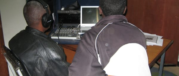 Two radio producers use a suitcase studio for broadcasts to North East Africa